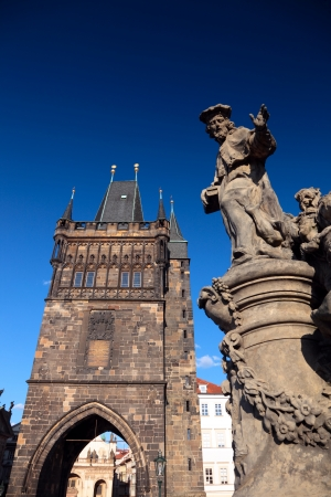 Tower and statue at the Charles Bridge in Prague, Czech Republic Stock Photo