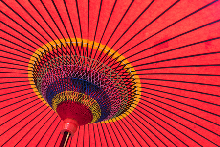 paper umbrella: Beautiful thread stitch of the Japanese umbrella Stock Photo