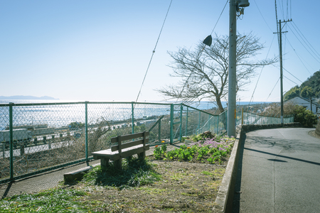 Scenery with bench  elevated along Suruga Bay