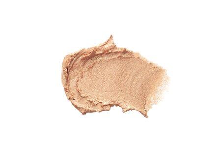 Smear of cream beige eyeshadows isolated on a white background.
