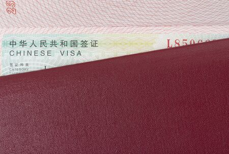 Chinese visa in a foreign passport close up, copy space.