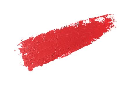Red smear of lipstick isolated on a white background, close-up