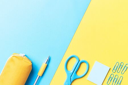 Stationery on a blue and yellow background, a copy space