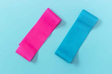 Elastic expanders on a blue background view from above, copy space