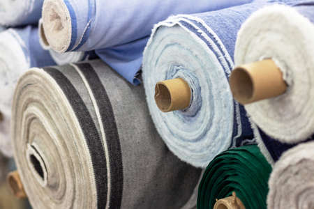 Stack of multicolored rolls with cloth close up, side view Archivio Fotografico