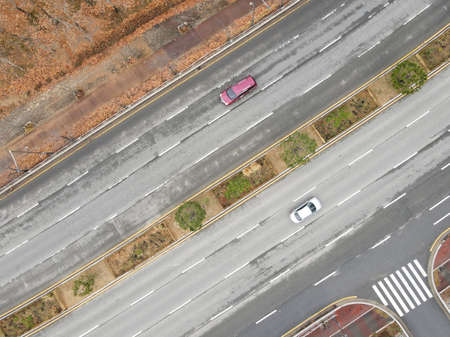 The movement of cars on a city road, top view ..