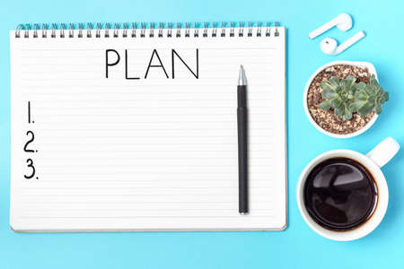 Business planning and pen on blue background, view from above Stock Photo