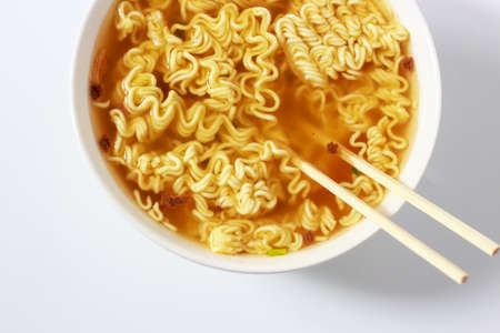 Instant noodles in bowls on white background top view Stock Photo
