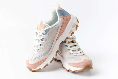 Pastel sneakers on white background copy of space, front view
