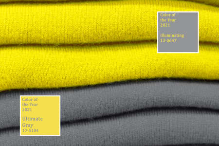 Stack of clothes trend colors 2021 illuminating and ultimate gray.