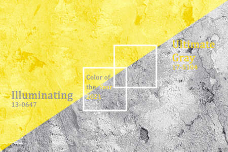 Concrete wall trendy color of year 2021 Illuminating and Ultimate gray. Stock Photo