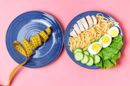 Plate with food and measuring tape on pink background, top view