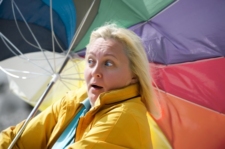 Woman with a broken umbrella photo