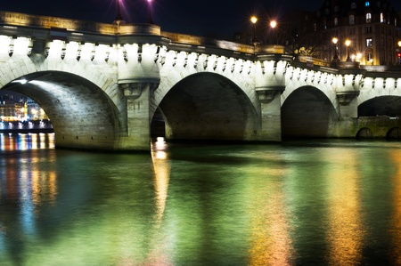 Seine river in Paris at night Stock Photo