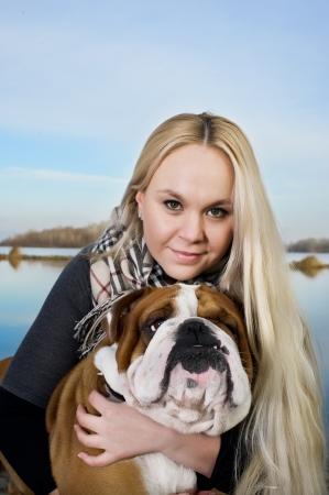 english girl: Beautiful woman with english bulldog Stock Photo