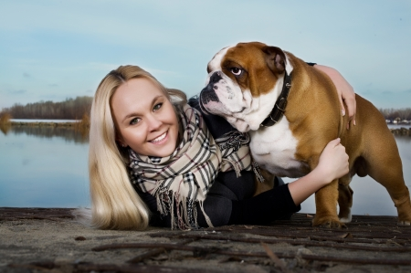 Beautiful woman with english bulldog photo