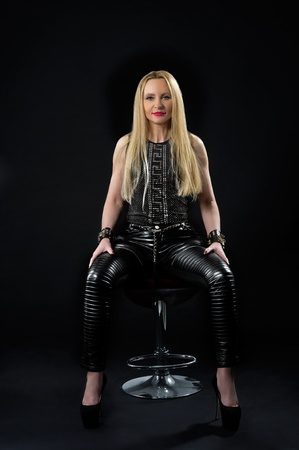 Studio portrait of beautiful young sexual blonde woman in stylish jewellery Stock Photo - 18917389