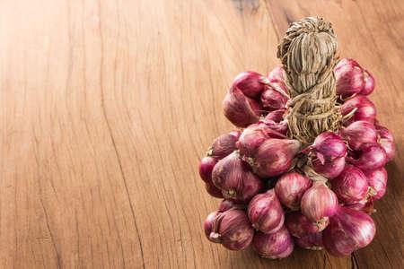 closeup shallot onion group on wood background