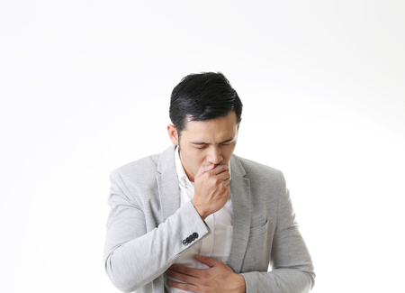 Portrait of coughing Asian Man in Isolated Background