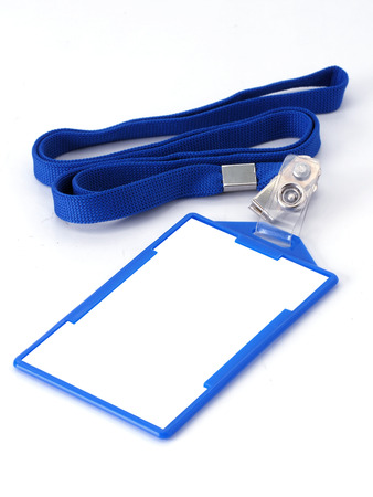 Blank fold and clip name tag or identification badge on blue woven lanyard strap.