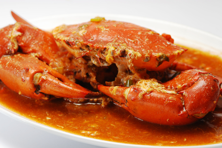 Chili crab with eggs, isolated on white.