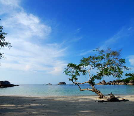 Scenic view of Tanjung Tinggi beach with blue sky and cloudscape background, Belitung, Indonesia.
