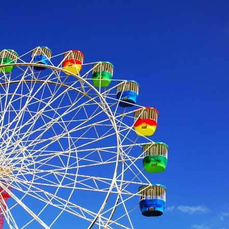 Ferris Wheel with blue sky as background