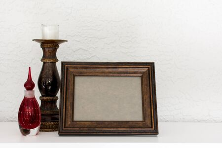 living things: empty frame on the shelf