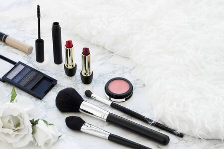 Fashion make up products in a white fur texture