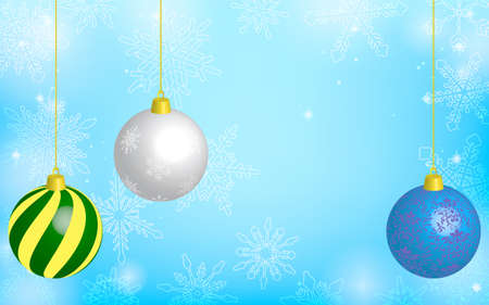 Christmas ball and blue sparkly snowflake background, with copy space