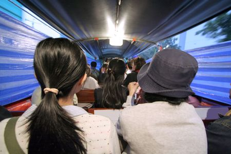 riders inside Bangkok water taxi