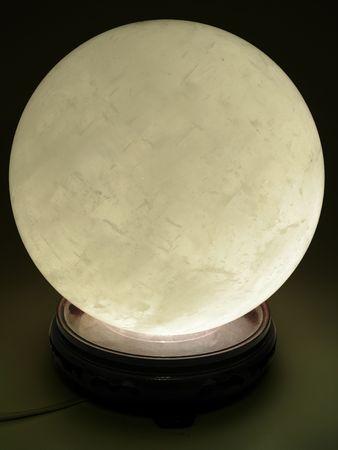 内から点灯している大きい水晶球 写真素材