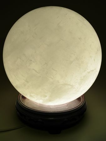 a large crystal ball illuminated from within