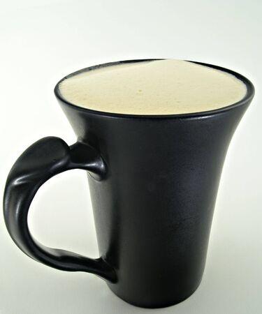 stylish black coffee cup with coffee Banco de Imagens