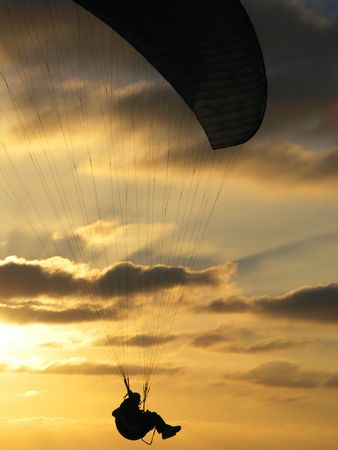 Hang glider over ocean sunset photo