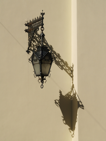 Old-fashion lantern casts the shadow   photo