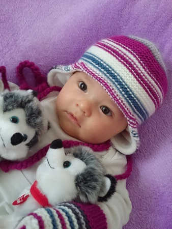 Cute baby girl with toys, winter theme. Stock Photo