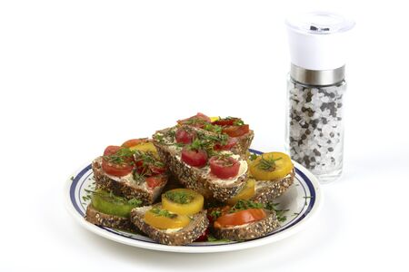 free plates: A plate of tomato sandwich on wholemeal bread and salt and pepper mill