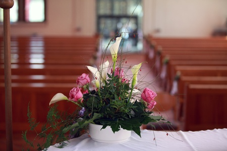 Very nice flower arrangement on the altar in the church before the wedding.