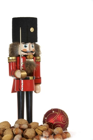 Traditional nutcracker with Christmas tree ball and nuts Stock Photo - 12125379