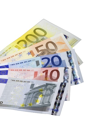 Euro banknotes widespread  in front of white background