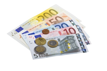 Euro bank notes and coins in front of white background