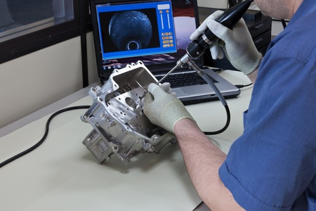 Video endoscopy  An employee checks a part of a gear case with the video endoscope