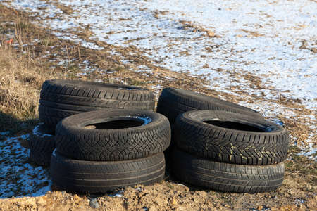 disposed: Illegally disposed of tires by the wayside Stock Photo