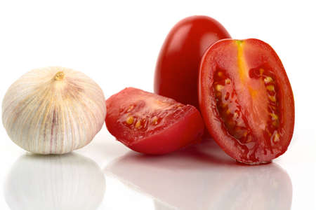 Fresh tomatoes with garlic onion on a white background photo