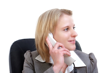 Portrait of a young businesswoman using phone in office Stock Photo - 13374083