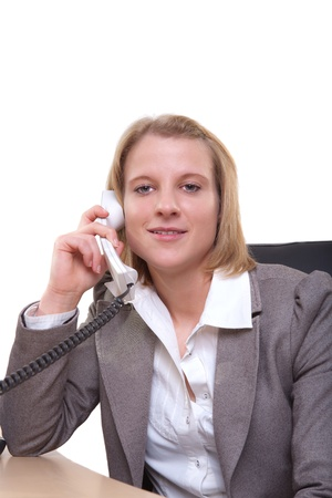 Portrait of a young businesswoman using phone in office Stock Photo - 13374119