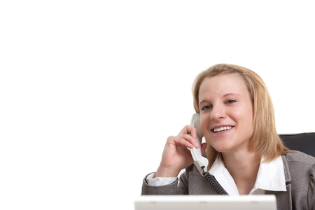 Portrait of a young businesswoman using phone in office Stock Photo - 13374067