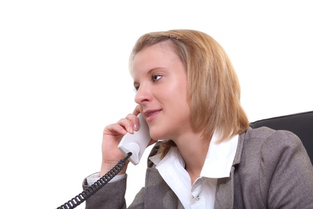 Portrait of a young businesswoman using phone in office Stock Photo - 13374089