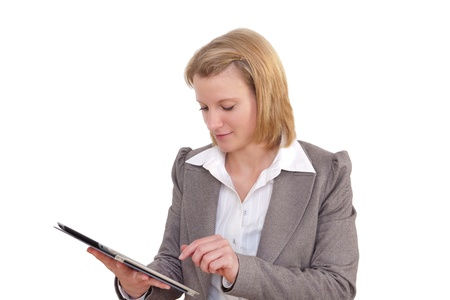 Young Business Woman works with a tablet pc Stock Photo - 13442105